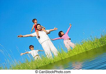Happy famili, meadow, river
