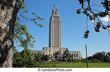 Louisiana State Capital building viewed through trees...