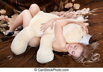 Naked beautiful young blonde sleeps