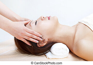 Facial massage - Beauty and Spa - Asian Girl having a...