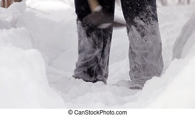 Man shoveling mass of snow - Man clearing deep snow off with...