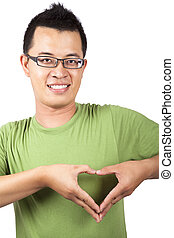 young man with two hand forming a heart shape