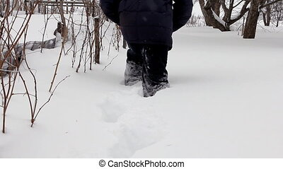 Man wades knee-deep through snow - Man walking forward in...