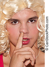 A man dressed as a woman picking his nose