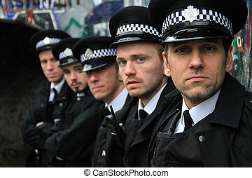 police line up - five police man standing in a line, with...