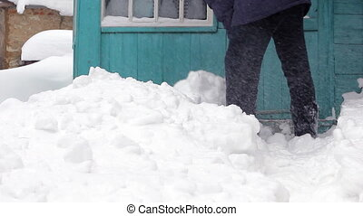 Man clearing snow off with shovel