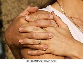 Loving couple holding hands in a park