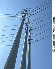 power poles against blue sky