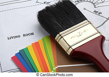 paint the house - paintbrush and color samples on a blue...