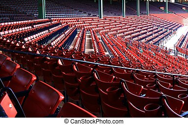 Sitting in the reds - Section of red seats at baseball...