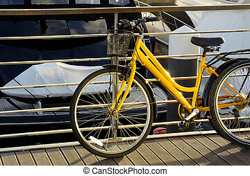 Yellow Bicycle - Detail of a yellow bicycle parked in a...