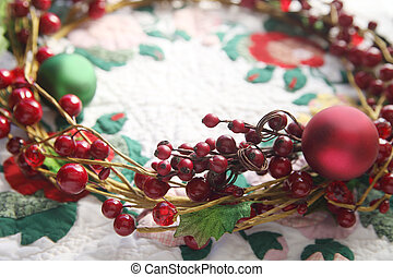 wreath with berries on a quilt