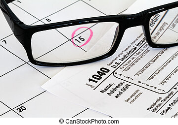 tax form with due date and reading glasses