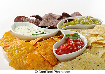 Three different dips guacamole, tomato-chili and cream...
