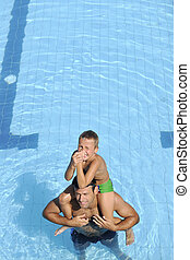 happy father and son at swimming pool - happy father and son...