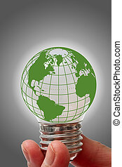 Light bulb with globe hold in hand