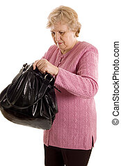 The elderly woman with a black bag
