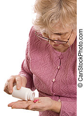 The elderly woman with tablets