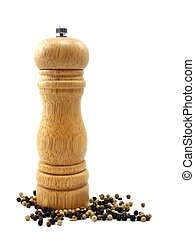 Peppermill with peppercorns - A wooden peppermill with...