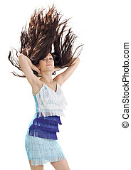 Young pretty lady in blue dress with long hairs flying upwards