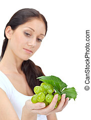 Young attractive woman with green grape cluster