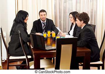 Four business people in meeting