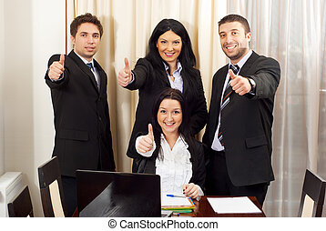 Cheerful business people giving thumbs up in a meeting room