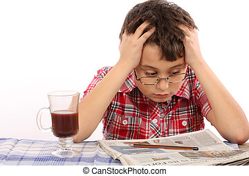 reader - kid in glasses reading newspaper
