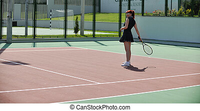 young woman play tennis game outdoor - young fit woman play...