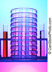 Stack of petri dishes in front of test tubes