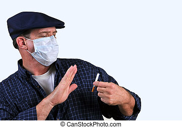 Man in mask fighting the urge - Man using a breathing mask...