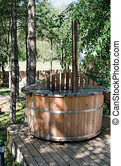 Wooden bathtub - Wooden sauna bathtub outdoor in the woods
