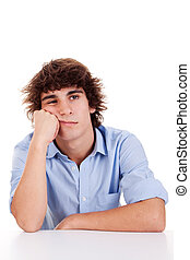 cute young man-teen, bored, isolated on white, studio shot