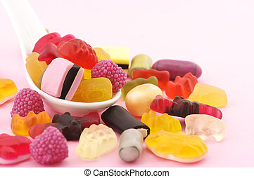 Colorful candy in spoon