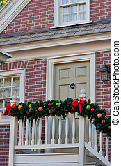 Porch Decorated For Christmas - Porch of a brick house...