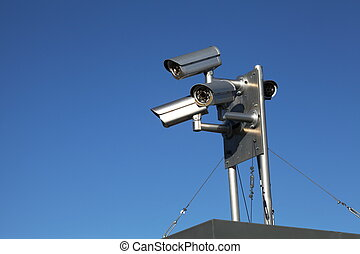 Rooftop Security Cameras - A close up of a rooftop unit with...