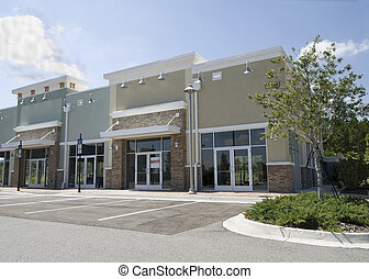 empty pastel strip mall - pastel, upscale strip mall with...