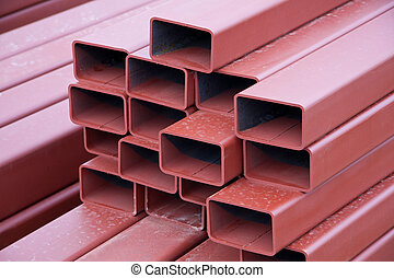 Steel Beams - A stack of painted steel box girders used in...