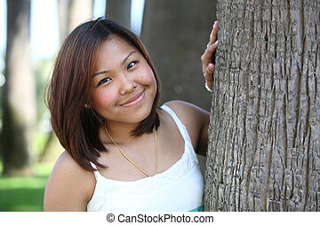 Portrait of pretty young asian woman with a lovely smile looking at the camera
