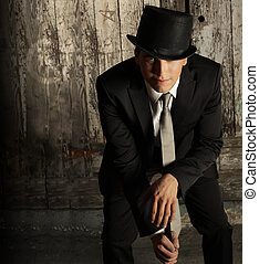 Man in top hat - Fashion portrait of young male model in top...
