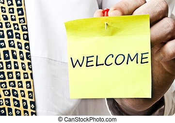 Welcome notice - Welcome post it in business man hand