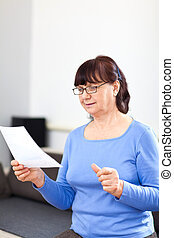 Senior woman reading something