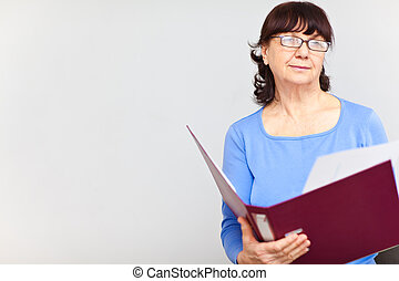 Nice senior woman with folder