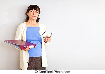 Senior woman with folder