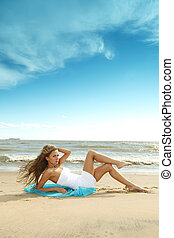 vacation - woman laying on sand sea on background