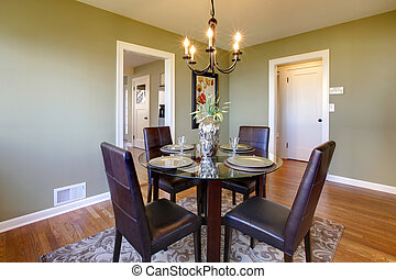 Classic dining room with leather chairs and glass table