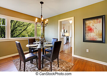 Classic dining room with leather chairs and glass tabl
