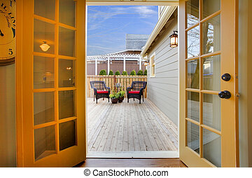View of the deck from open kitchen french door