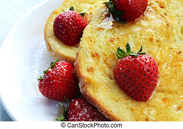 French Toast with Strawberries - French toast topped with...