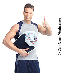 man with a weight scale - Healthy young man with a weight...